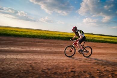 man biking in motion